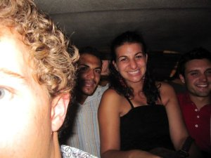 Half of Jeff's head, Omar, me and Charles squashed in the cab, but still ridiculously happy!