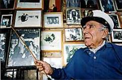 An old photo of Pepe Abed, showing off his photo wall of fame