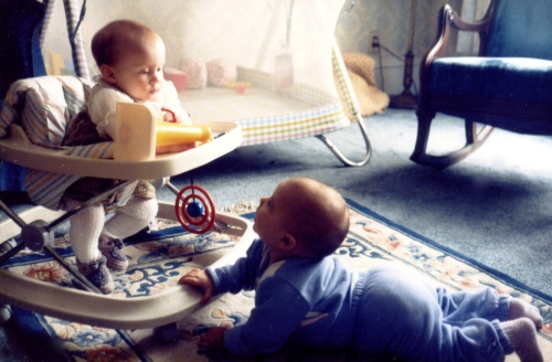 Told 'ya - friends from birth :) Lilly and I as babies. I'm the adorably fat, bald lump on the floor ;)